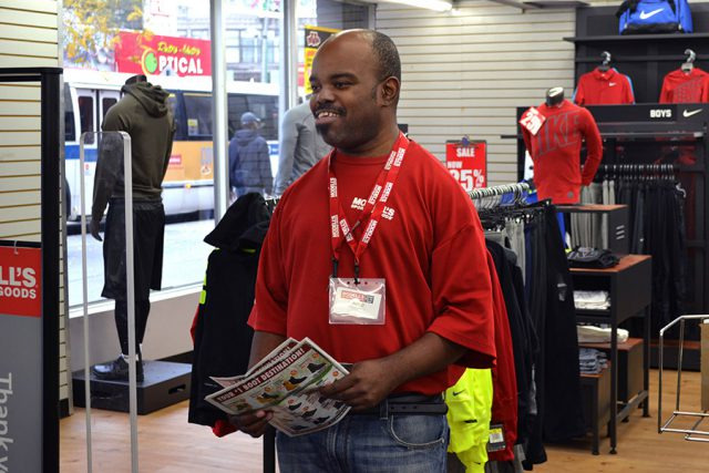 man at modell's store