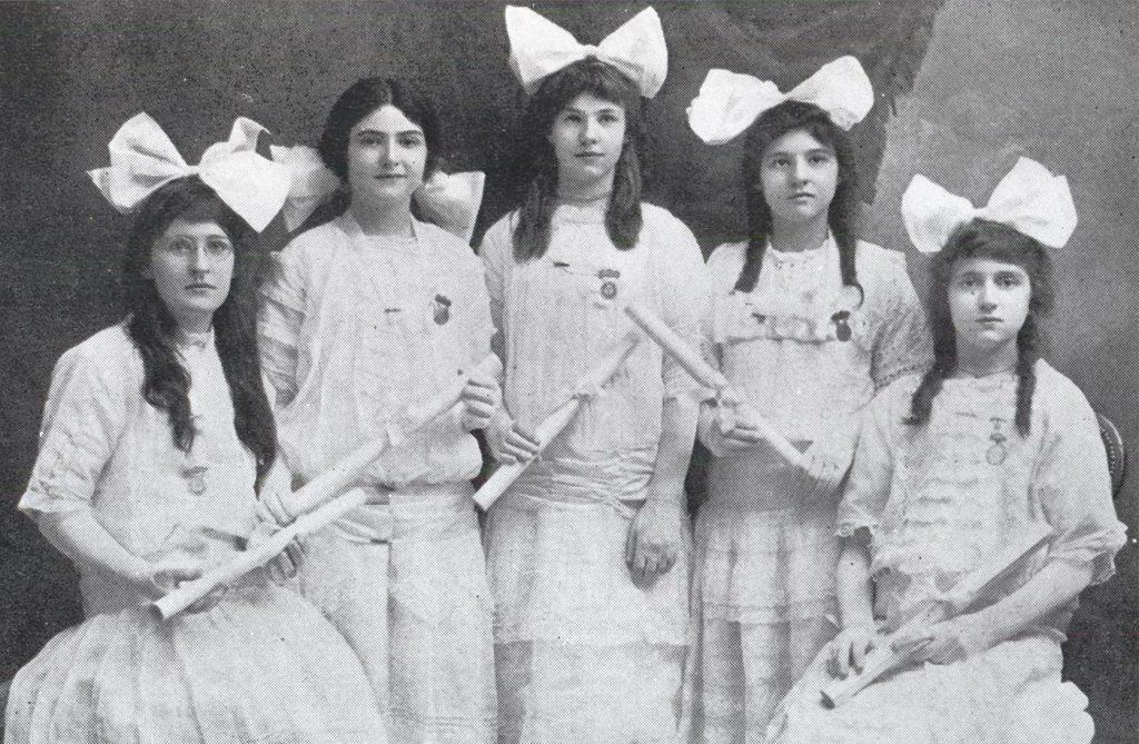 five women in dresses